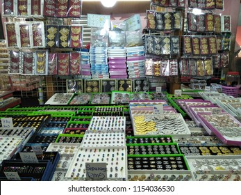 KOTA BAHRU, MALAYSIA - August, 2018: A gold brooch jewelry grocery booth in Siti Khadijah Market in Kota Bahru, Kelantan, Malaysia. Siti Khadijah Market is an all lady Muslim market.