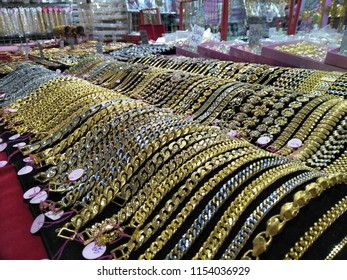 KOTA BAHRU, MALAYSIA - August, 2018: A gold necklace jewelry accessories grocery booth in Siti Khadijah Market in Kota Bahru, Kelantan, Malaysia. Siti Khadijah Market is an all lady Muslim market.