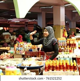 KOTA BAHRU, MALAYSIA - MAR 6, 2011: A lady vendor at her stall in Siti Khadijah Market in Kota Bahru, Kelantan, Malaysia. Siti Khadijah Market is an all lady market in the muslim enclave of Kelantan.