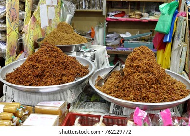 KOTA BAHRU, MALAYSIA - MAR 6, 2011: Spicy meat floss on display at a food stall in Siti Khadijah Market in Kota Bahru, Malaysia. The spicy meat floss known as Serunding is a traditional Malay delicacy