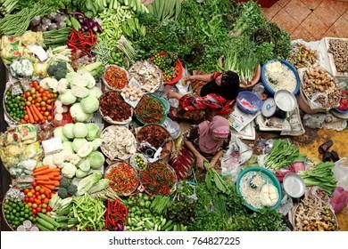 KOTA BAHRU, MALAYSIA - MAR 6, 2011: Lady vendors at their stall in Siti Khadijah Market in Kota Bahru, Kelantan, Malaysia. Siti Khadijah Market is an all lady market in the Muslim enclave of Kelantan.
