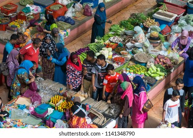 KOTA BAHRU, MALAYSIA - OCT 23, 2016: Lady vendors and customers trading at the Pasar Siti Khadijah stall. The market is mostly run by women.