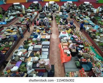 KOTA BAHRU,KELANTAN, MALAYSIA - August, 2016: Vendors and customers trading at the Pasar Siti Khadijah stall. Siti Khadijah Market is market in the muslim enclave of Kelantan state in Malaysia.