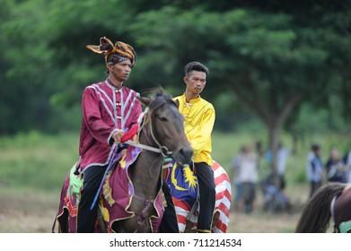 Kota Belud Sabah Malaysia - Oct 23, 2016 : Bajau Samah in traditional costume riding a decorated horse during Tamu Besar festival. The Kota Belud Bajau Samah are the famous Cowboys of the East.