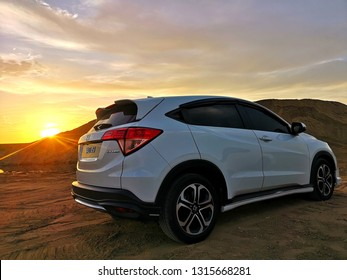 Kota Bharu - 16 Feb 2019 : Honda HRV in the desert at sunrise. Honda HRV is the most popular SUV in Malaysia.