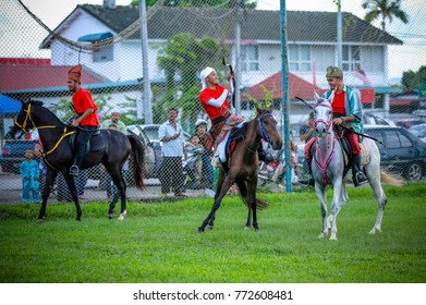 KOTA BHARU - DECEMBER 07, 2017 : muslim warrior ride a horse with arrow at the open place.