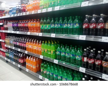 Kota Bharu Kelantan , Malaysia - 10 April 2018 : Assorted of carbonated drink bottle display on the supermarket shelves.