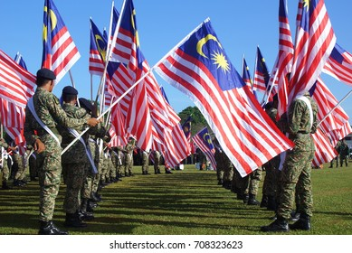 Kota Bharu, Kelantan, Malaysia 31st August 2017 - Group Of Malaysian Army Holding Malaysia Flag During 60th Malaysia Independence Day celebration