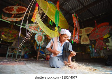 KOTA BHARU, MALAYSIA - APRIL 7 :  The master kite maker, Shafie Bin Jusoh works on his craft in a small hut near the Cahaya Bulan Beach, April 7, 2009 in Kota Bharu, Malaysia