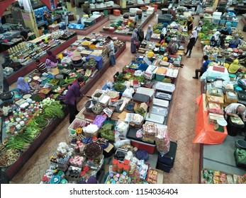 KOTA BHARU,KELANTAN, MALAYSIA - August, 2016: Vendors and customers trading at the Pasar Siti Khadijah stall. Siti Khadijah Market is market in the muslim enclave of Kelantan state in Malaysia.