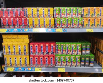Kota Kemuning, Malaysia - 22 May 2019 : Assorted a box of SUNQUICK fruits juice flavour mixed drink display for sale on the supermarket shelves with selective focus.