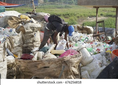 KOTA KINABALU, MALAYSIA - 09 JULY, 2017: Unidentified man collecting plastic bottle and unused item for recycle and resell at dumping site landfill at Kota Kinabalu,Sabah.Borneo.
