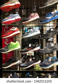 KOTA KINABALU, MALAYSIA - 17 MARCH, 2019:  Salomon shoe brand display for sale at the Salomon store. The Salomon Group is a famous sports equipment manufacturing company.