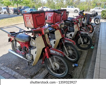 KOTA KINABALU, MALAYSIA - 2 APRIL, 2019 :  A row of Pizza Hut delivery motorcycles in the downtown. Pizza Hut, Inc. is a subsidiary of Yum! Brands, Inc., the worlds largest restaurant company.