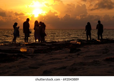 Kota Kinabalu, Malaysia 2 August 2017 : Silhouette of tourists on the beach of Mantanani Island. The island is located off the coast of Kota Kinabalu and popular for it's beautiful nature.