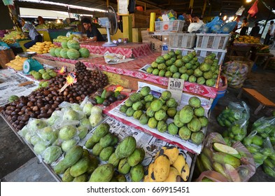 KOTA KINABALU, MALAYSIA- 24 JUN 2017: Fruit stalls in Kota Kinabalu Sabah, Malaysia. Fresh fruits and farm produce are easily available in this traditional wet market.