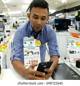 KOTA KINABALU, MALAYSIA - August 18, 2017: Unidentified Sony Sales person at Sony Centre Karamunsing in Kota Kinabalu, Malaysia.  Sony is one of the leading manufacturers of electronic products.