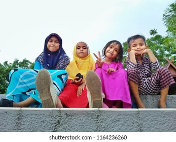 "Kota Kinabalu, Malaysia, August 22, 2018 : Malay kids wearing a tradition clothe of Malay Culture call ""Baju Melayu"" and ""Baju Kurung"" at the recreation park in Kota Kinabalu"