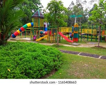 Kota Kinabalu, Malaysia, August 22, 2018: A few kids happily playing at colourful playground in Kota Kinabalu.
