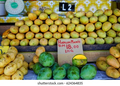 KOTA KINABALU, MALAYSIA -  CIRCA APRIL 2017: Green and yellow mangoes are sold at a price of RM 18 per kilo on April 12, 2017 in Kota Kinabalu, Malaysia.
