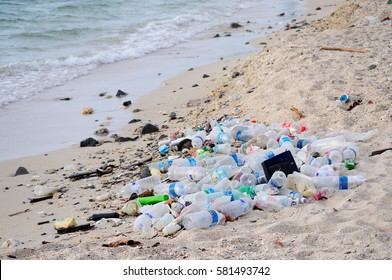KOTA KINABALU, MALAYSIA - MARCH 13, 2016: Garbage and plastic bottles on a beach left in Kota Kinabalu beach.