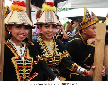 KOTA KINABALU, MALAYSIA - MAY 30 : Kadazan Papar ladies in their traditional costume poses for the public during Harvest Festival celebration May 30, 2014 in Kota Kinabalu, Sabah, Malaysia.