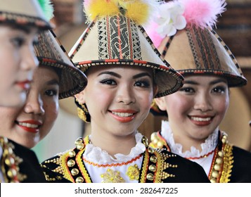 Kota Kinabalu, Malaysia - May 30, 2015: Kadazan Papar ladies in their traditional costume pose for the camera during the Sabah State Harvest festival celeberation in Kota Kinabalu, Sabah, Malaysia.