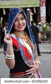 KOTA KINABALU, MALAYSIA - MAY 30, 2015: Smiling Kadazan Dusun girl wearing colorful traditional costume during Sabah Harvest festival in Kota Kinabalu, Sabah Borneo, Malaysia.