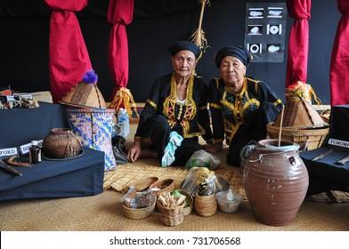 Kota Kinabalu, Malaysia - May 30, 2015: Two Bobohizan or Bobolian or high priestess or a spirit medium in Kadazan-Dusun pagan rites during annual Harvest Festival or Kaamatan held in Sabah Borneo.