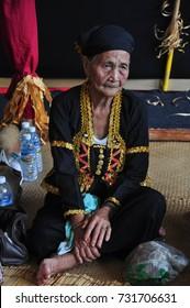 Kota Kinabalu, Malaysia - May 30, 2015: Bobohizan or Bobolian or high priestess or a spirit medium in Kadazan-Dusun pagan rites during annual Harvest Festival or Kaamatan held in Sabah Borneo.