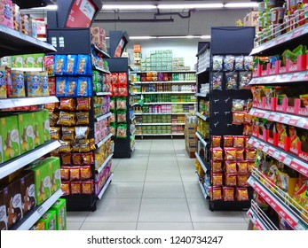 Kota Kinabalu, Malaysia - November 25, 2018: Interior view with busy customer looking for their daily needs in the Hypermarket at Kota Kinabalu.
