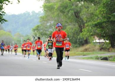 Kota Kinabalu, Sabah - 4 february 2021 : a man was jogging while putting a head phone on his head