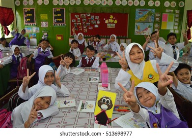 Kota Kinabalu, Sabah. April 7, 2016: A bunch of gleeful looking Malaysian school children in their classroom in Sk. Kolombong. Early childhood educatio is compulsory in Malaysian education system.