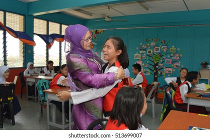 Kota Kinabalu, Sabah. April, 7 2016: A teacher compliment  a student's achivement by giving her a hug  at Sk. Kolombong. Students' motivation is said to improve with positive feedback from teacher.