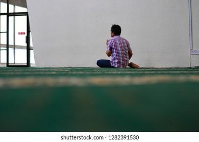 KOTA KINABALU, SABAH - DECEMBER 2018: A mas praying at the beautiful mosque