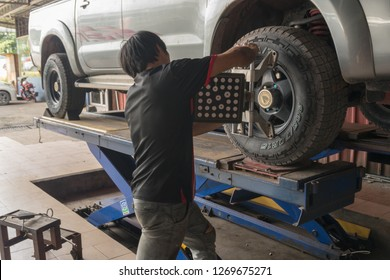 Kota Kinabalu, Sabah - DECEMBER 21, 2018: Wheel alignment or an adjustment of a vehicle's suspension at Kolombong Tyre Workshop in Inanam, Kota Kinabalu, Sabah. Editorial.