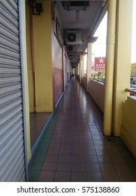 KOTA KINABALU SABAH - FEB 8, 2017: 5 foot walkway for 3 storey shophouses with tiled floor finished.