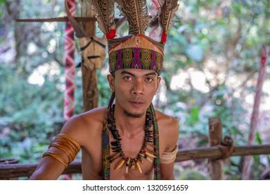 Kota Kinabalu, Sabah / Malaysia - 02.07.2019: residents of Mari Mari Cultural Village - Murut people. Murut man is headhunter