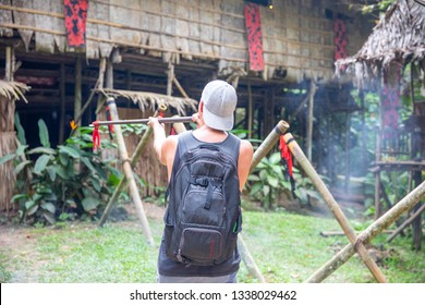 Kota Kinabalu, Sabah / Malaysia - 02.07.2019:The tourist from Germany shoots the poisoned arrow at a target. attraction for tourist in Mari Mari Cultural Village - Murut people (headhunters tribe)