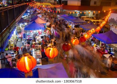 Kota Kinabalu Sabah Malaysia.Feb 3, 2019 : Crowded people in motion at night market on Feb 3, 2019 in Kota Kinabalu, Sabah.Night market is popular spot among Malaysian to buy bargain items.