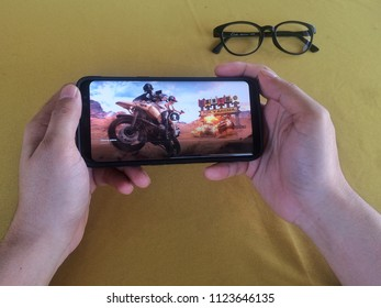 Kota Kinabalu, Sabah. Malaysia : 30 June 2018 - hand holding cellphone. PUBG most famous mobile games. It can be download at Appstore on ios and Playstore on Android.