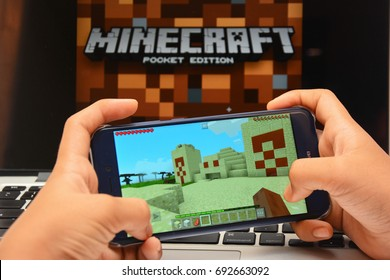 Kota Kinabalu Sabah Malaysia - Aug 8, 2017: Minecraft game plays on mobile phone. Educators encourage to re-design their educational curricular into an interactive and media-rich learning environment.