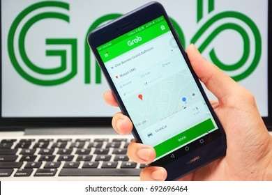 Kota Kinabalu Sabah Malaysia - Aug 8, 2017: Grab services on mobile phone.  Many Malaysian youth are attracted to join the ride sharing services business of Uber and Grab.