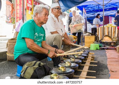 "Kota Kinabalu Sabah Malaysia - Aug 6 ,2017: Street scene of local people play a traditional instrument call ""Gulingtangan"" at Sunday Market, Sabah is known for its natural tropical beauty."