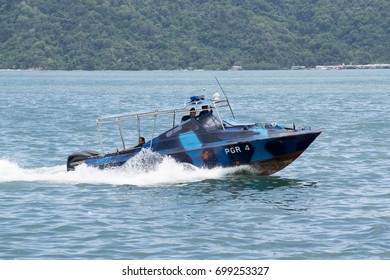 Kota Kinabalu Sabah Malaysia - Aug 19, 2017 : Malaysian Police patrol boat seen patrolling Kota Kinabalu waterfront on Aug 19, 2017. The routine is to combat illegal activity in this area.