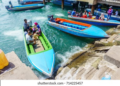 KOTA KINABALU SABAH, MALAYSIA - AUG 31, 2017: People ride a boat to nearest road access at Kota Kinabalu. Boat is a water taxi to cross the sea for generation to Pulau Gaya from Kota Kinabalu Town.