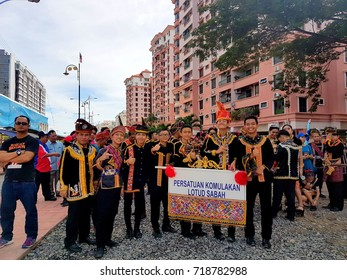 Kota Kinabalu Sabah, Malaysia - August 31, 2017 :Colorful Independence Day Parade participants pose for camera on Merdeka Day.