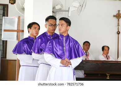 KOTA KINABALU, SABAH MALAYSIA - DEC 10, 2017: Catholic priest and altar boys preparation of the gifts, Eucharistic Prayer in catholic church on third advent service mass in St Catherine church, Sabah