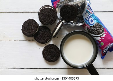 Kota Kinabalu, Sabah Malaysia - Feb 1, 2019: Oreo Cookies on white wooden pallet background served with fresh milk. Oreo is a sandwich cookie with a sweet cream filling in between.