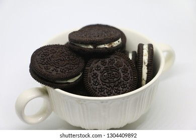 Kota Kinabalu, Sabah Malaysia - Feb 1, 2019: Oreo Cookies in white bowl on white isolated background. Oreo is a sandwich cookie with a sweet cream filling in between.